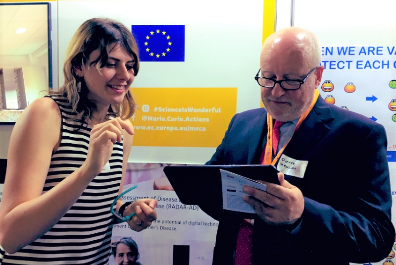Alina Ivan, Research Assistant in the Department of Psychological Medicine at King's College London with Pierre Meulien Executive Director of the Innovative Medicines Initiative (IMI)